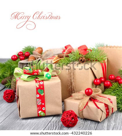 Christmas gift boxes on a wooden background. Packing from a kraft paper. A Christmas background with space for the text. - stock photo