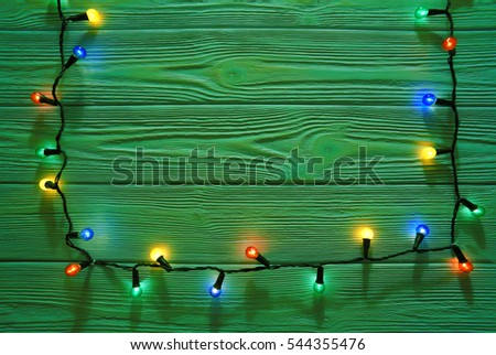 Christmas green color wooden rustic  background decorated with shining lights
