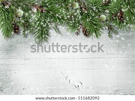 Christmas greeting card with fir branch, berry and cones