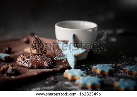 Christmas homemade chocolate chip cookies, star and cinnamon sticks on a wooden background. - stock photo