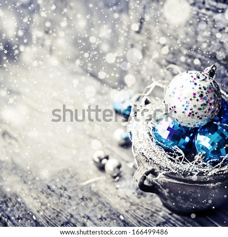 Christmas Ornament Background/ Christmas decorations in old pot on textured wooden background/ Composition with Brilliant Christmas Balls - stock photo