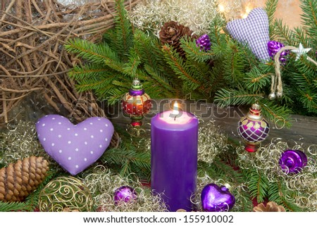 Christmas purple ornaments on window sill - stock photo