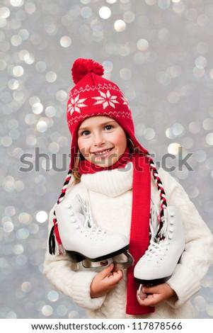Christmas, winter - Ice skating girl at Christmas time - stock photo