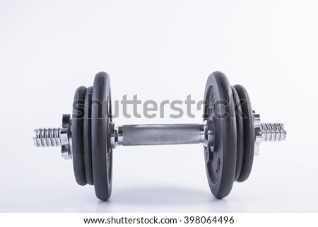 chrome dumbell isolated on the white background - stock photo