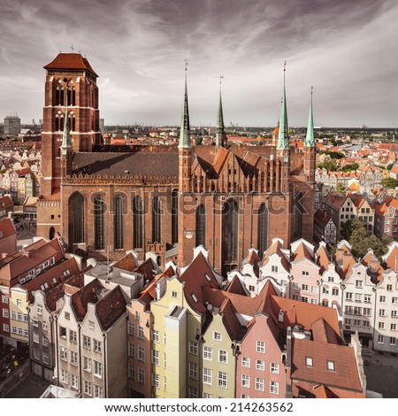 Church of the Blessed Virgin Mary (Polish: Bazylika Mariacka) and roofs of Gdansk city centre - stock photo