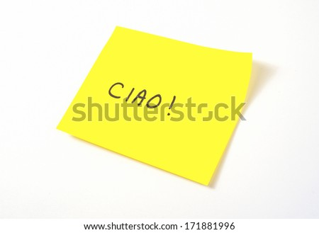 'Ciao' written on a yellow sticky note (Italian term for 'hi' or 'bye') - stock photo