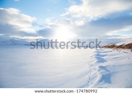 Cildir lake is covered snow under cloudy sky, Kars Turkey - stock photo