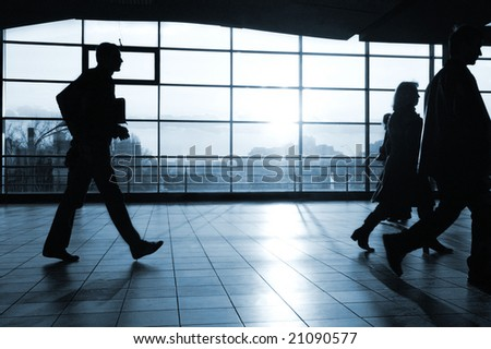 City people walking in a futuristic tunnel