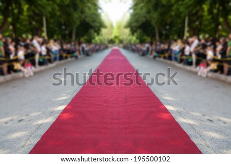 classic red carpet over street - stock photo