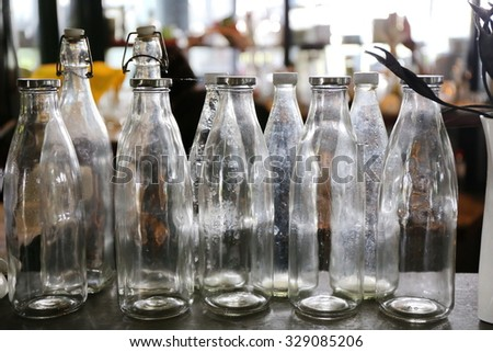 clear glass bottle on table - stock photo