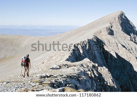 Climber walking on high mountain - stock photo