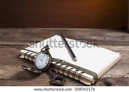 clock, book  and felt pencil. Schoolchild and student studies accessories. Back to school concept.