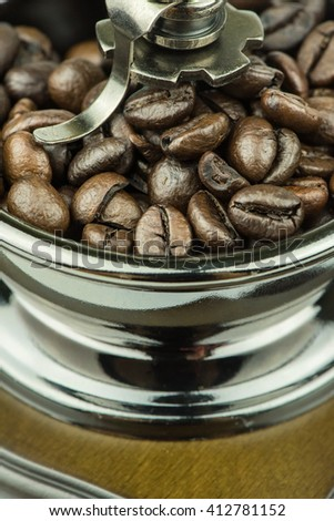 Close up coffee grinder and coffee beans. - stock photo