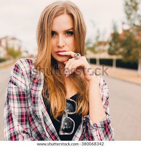 Close up fashion portrait  of young  sensual  attractive blonde  woman   posing in countryside  . Sunny spring  day.  Soft toned photo.  - stock photo