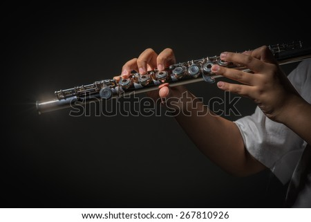 close up hand little boy playing flute on back