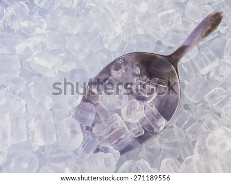 close up ice cubes and stainless ice scoop