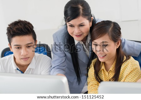 Close-up image of students and their teacher having fun at the lesson - stock photo