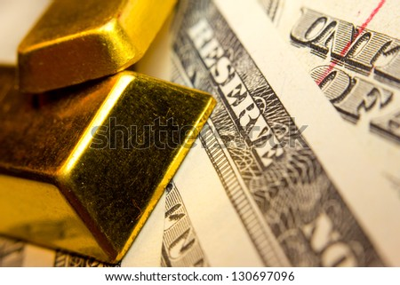 Close-up of a 20 dollar banknote note and gold bullions - stock photo