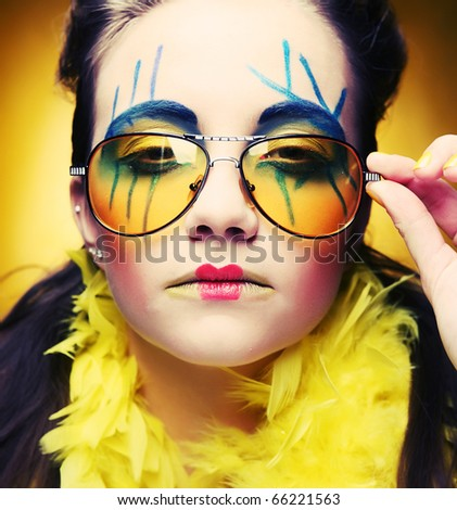 close up of a face of a girl with creative visage - stock photo