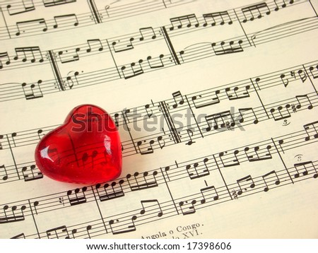 Close up of a music score and a red heart - stock photo
