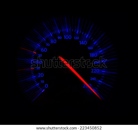 close up of automobile speedometer on blue - stock photo