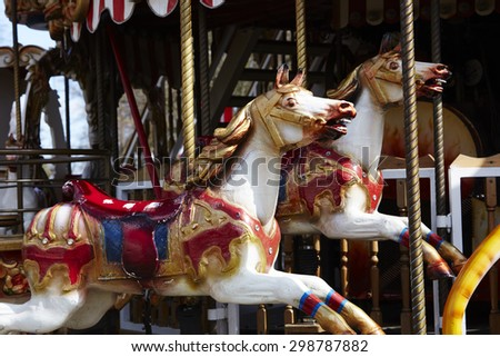 Close up of carousel horses in fairground