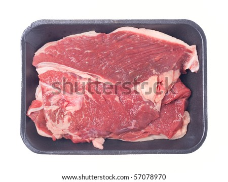 Close up of  steak, on pack,  isolated on white background. - stock photo