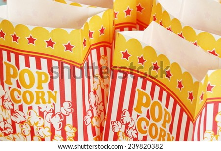 close up of two empty striped popcorn bag - stock photo