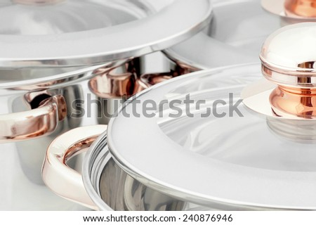 Close-up on cooking pots made of stainless steel. - stock photo