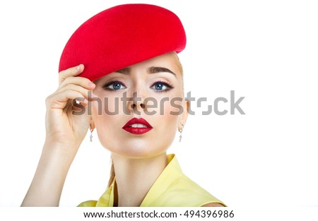 close  up portrait of a girl in a red hat