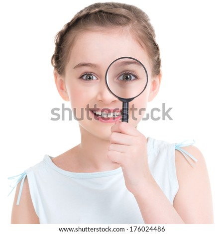 Close-up portrait of cute little girl looking through a magnifying glass - isolated on white. - stock photo