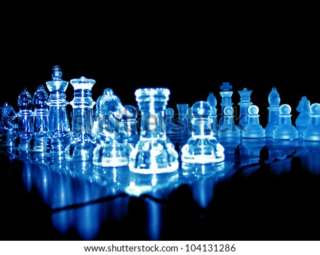 close up shot of glass chess pieces over black background