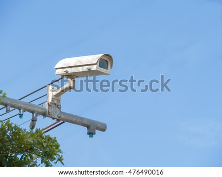 closed-circuit camera on blue background,