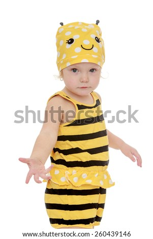 closeup of a pretty little girl in a striped suit bee- isolated on white.