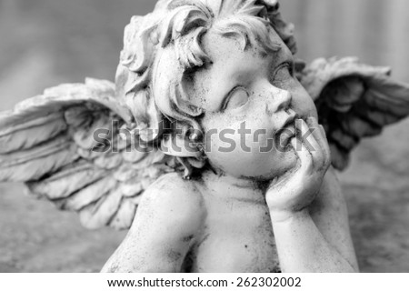 closeup of cherub figurine in black and white , Italy - stock photo