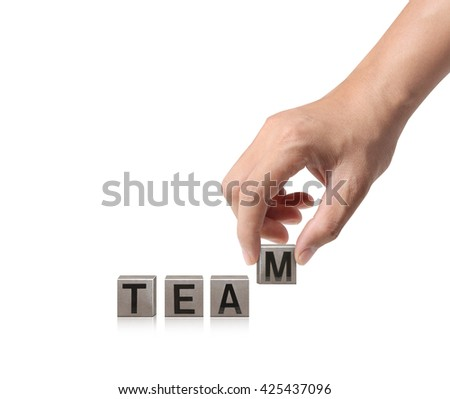 Closeup of hand putting together word  - stock photo