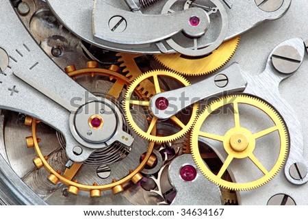 Closeup of metal clock works. - stock photo