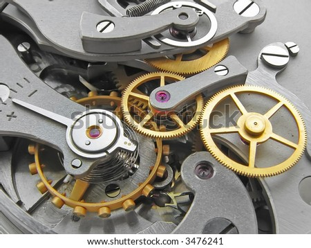 Closeup of metal clock works. - stock photo