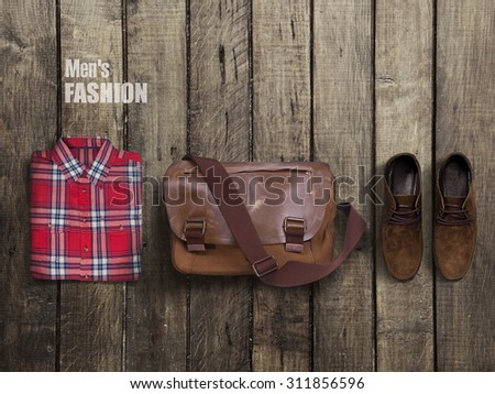 clothes and accessories on a wooden background - stock photo