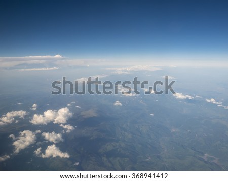 Cloud in blue sky view from aircraft window - stock photo