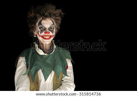 .Clown on black background - stock photo