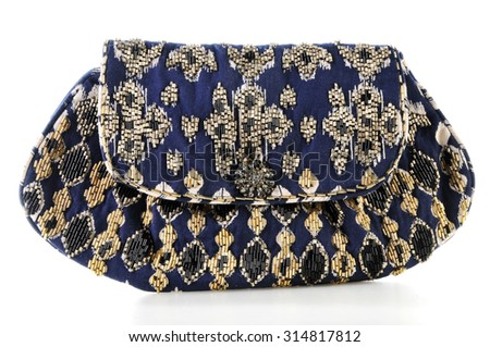 clutch bag embroidered with beads isolated on white - stock photo