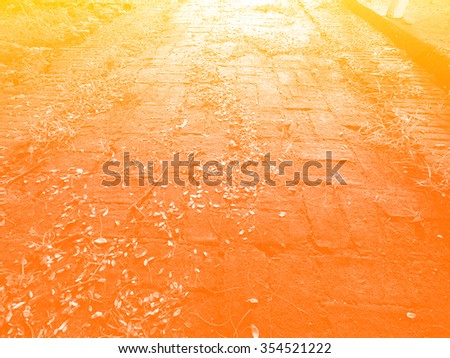cobblestone road in the evening light - stock photo