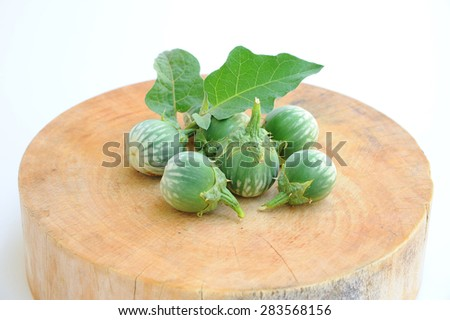 Cockroach Berry, Brinjal place on wooden, white background  - stock photo