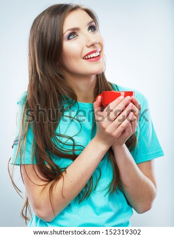 Coffee cup. Young woman on isolated studio background. Beautiful girl portrait. Female model poses. - stock photo