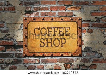 Coffee shop sign on rusted metal plate, rusted, riveted edges.That, on a very old brick wall./ Rusted Coffee Sign on 1890's Brick / Grunge for sure, good look for espresso bar, cafe, or coffee shop. - stock photo
