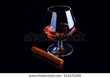 Cognac and Cigar on black background - stock photo