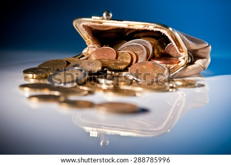 Coins out of the purse - stock photo