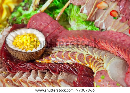 cold cuts meat  on banquet table in buffet - stock photo