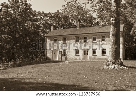 """""""Colonial Building Sepia"""" A sepia toned colonial building in historic Allaire Village in New Jersey. - stock photo"""